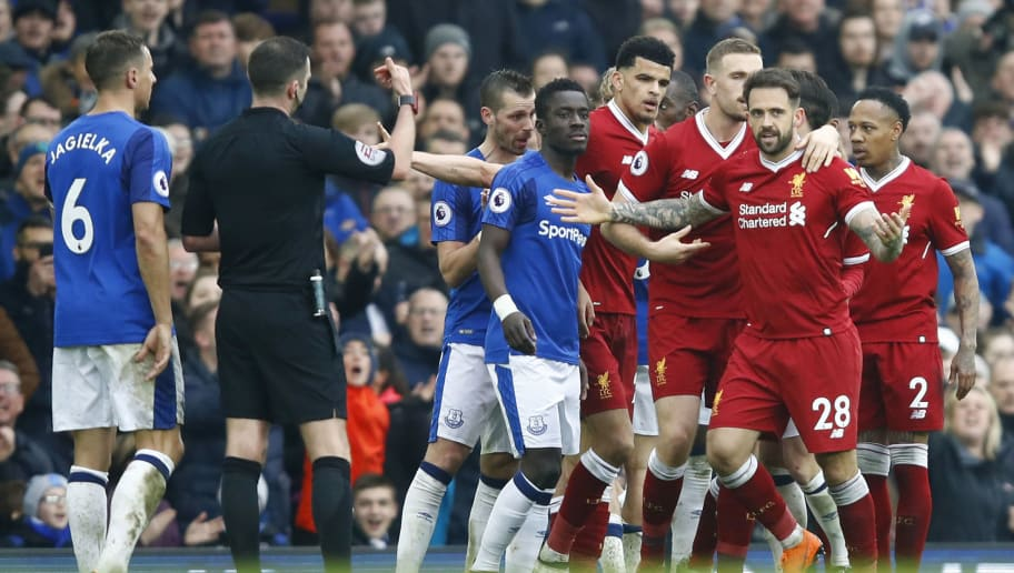 LIVERPOOL, ENGLAND - APRIL 07:  Phil Jagielka of Everton and Danny Ings of Liverpool clash during the Premier League match between Everton and Liverpool at Goodison Park on April 7, 2018 in Liverpool, England.  (Photo by Julian Finney/Getty Images)