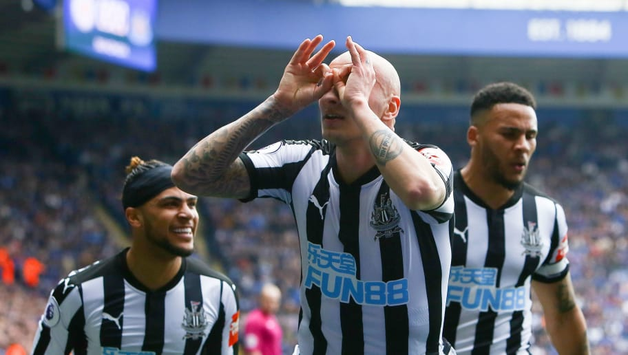Newcastle United's English midfielder Jonjo Shelvey (C) celebrates scoring the opening goal during the English Premier League football match between Leicester City and Newcastle United at the King Power Stadium in Leicester, central England on April 7, 2018. / AFP PHOTO / Geoff CADDICK / RESTRICTED TO EDITORIAL USE. No use with unauthorized audio, video, data, fixture lists, club/league logos or 'live' services. Online in-match use limited to 75 images, no video emulation. No use in betting, games or single club/league/player publications.  /         (Photo credit should read GEOFF CADDICK/AFP/Getty Images)