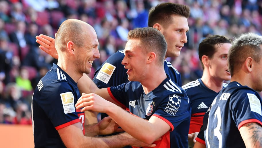 AUGSBURG, GERMANY - APRIL 07: Arjen Robben (l) of Bayern Muenchen celebrates scoring his teams third goal with teammate Joshua Kimmich during the Bundesliga match between FC Augsburg and FC Bayern Muenchen at WWK-Arena on April 7, 2018 in Augsburg, Germany. (Photo by Sebastian Widmann/Bongarts/Getty Images)