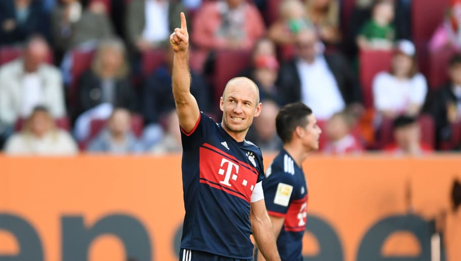 Bayern Munich's Dutch midfielder Arjen Robben reacts after his goal during the German first division Bundesliga football match FC Augsburg vs FC Bayern Munich in Augsburg, southern Germany, on April 7, 2018. / AFP PHOTO / Christof STACHE / RESTRICTIONS: DURING MATCH TIME: DFL RULES TO LIMIT THE ONLINE USAGE TO 15 PICTURES PER MATCH AND FORBID IMAGE SEQUENCES TO SIMULATE VIDEO. == RESTRICTED TO EDITORIAL USE == FOR FURTHER QUERIES PLEASE CONTACT DFL DIRECTLY AT + 49 69 650050         (Photo credit should read CHRISTOF STACHE/AFP/Getty Images)
