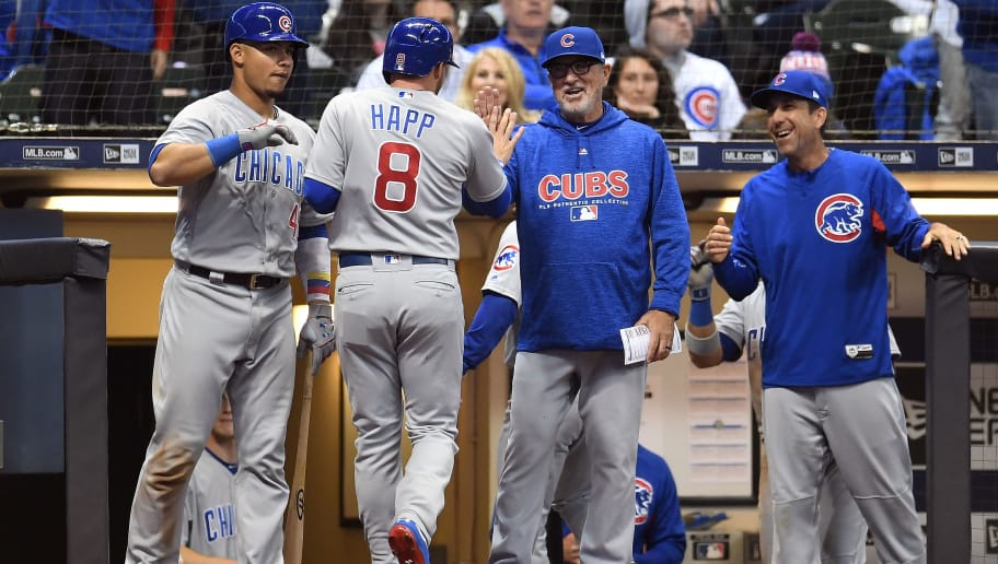 MILWAUKEE, WI - APRIL 05:  Ian Happ #8 of the Chicago Cubs is congratulated by manager Joe Maddon #70 after scoring against the Milwaukee Brewers during the eighth inning at Miller Park on April 5, 2018 in Milwaukee, Wisconsin.  (Photo by Stacy Revere/Getty Images)