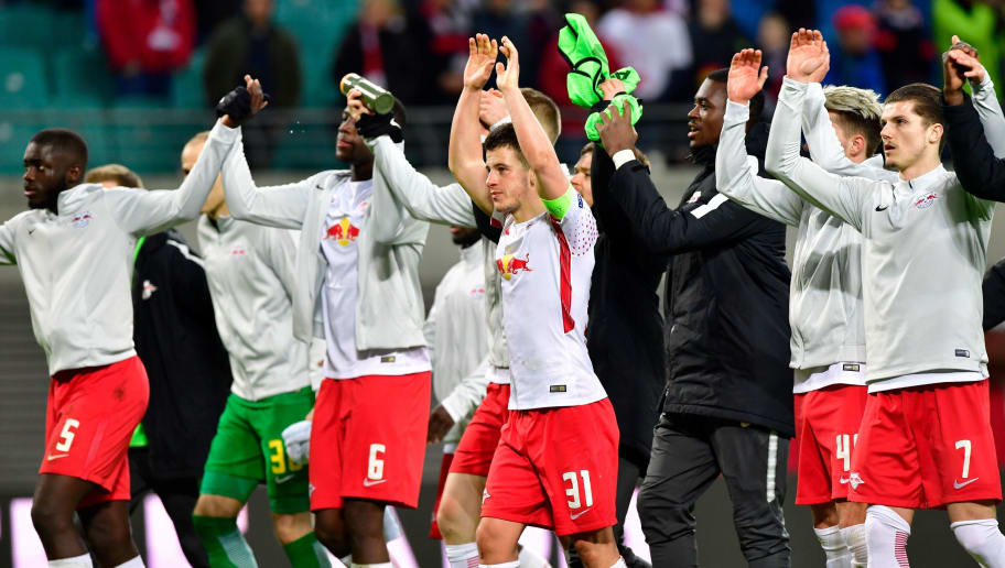 Leipzig players celebrate with the crowd after the UEFA Europa League quarter-final first leg football match RB Leipzig vs Olympique de Marseille (OM) at the RB arena in Leipzig, eastern Germany, on April 5, 2018. / AFP PHOTO / John MACDOUGALL        (Photo credit should read JOHN MACDOUGALL/AFP/Getty Images)