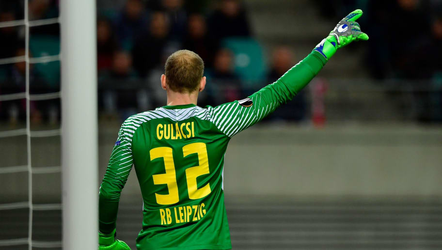 Leipzig's Hungarian goalkeeper Peter Gulacsi gestures during the UEFA Europa League quarter-final first leg football match RB Leipzig vs Olympique de Marseille (OM) at the RB arena in Leipzig, eastern Germany, on April 5, 2018. / AFP PHOTO / John MACDOUGALL        (Photo credit should read JOHN MACDOUGALL/AFP/Getty Images)