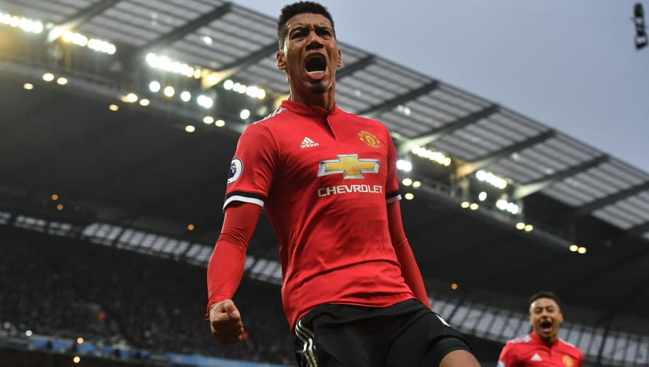 Manchester United's English defender Chris Smalling celebrates scoring their third goal during the English Premier League football match between Manchester City and Manchester United at the Etihad Stadium in Manchester, north west England, on April 7, 2018. / AFP PHOTO / Ben STANSALL / RESTRICTED TO EDITORIAL USE. No use with unauthorized audio, video, data, fixture lists, club/league logos or 'live' services. Online in-match use limited to 75 images, no video emulation. No use in betting, games or single club/league/player publications.  /         (Photo credit should read BEN STANSALL/AFP/Getty Images)