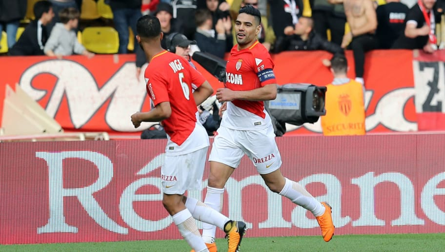 Monaco's Colombian forward Radamel Falcao (R) celebrates after scoring a goal during the French L1 football match Monaco vs Nantes on April 7, 2018 at the 'Louis II Stadium' in Monaco.   / AFP PHOTO / VALERY HACHE        (Photo credit should read VALERY HACHE/AFP/Getty Images)