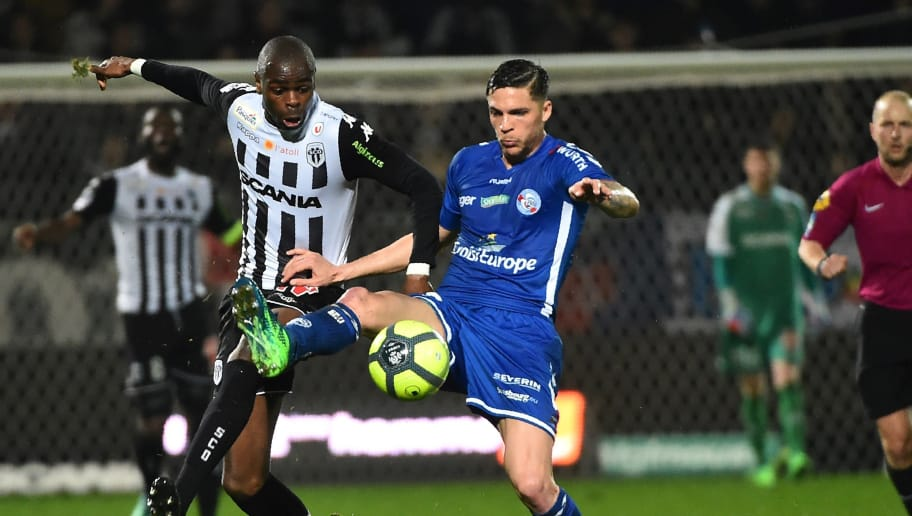 Anger's Congolese midfielder Prince Oniangue (L) vies with Strasbourg's French midfielder Jonas Martin (R) during the French L1 football match between Angers (SCO) and Strasbourg (RCSA), on April 7, 2018 at the Raymond-Kopa stadium, in Angers, northwestern France.  / AFP PHOTO / JEAN-FRANCOIS MONIER        (Photo credit should read JEAN-FRANCOIS MONIER/AFP/Getty Images)