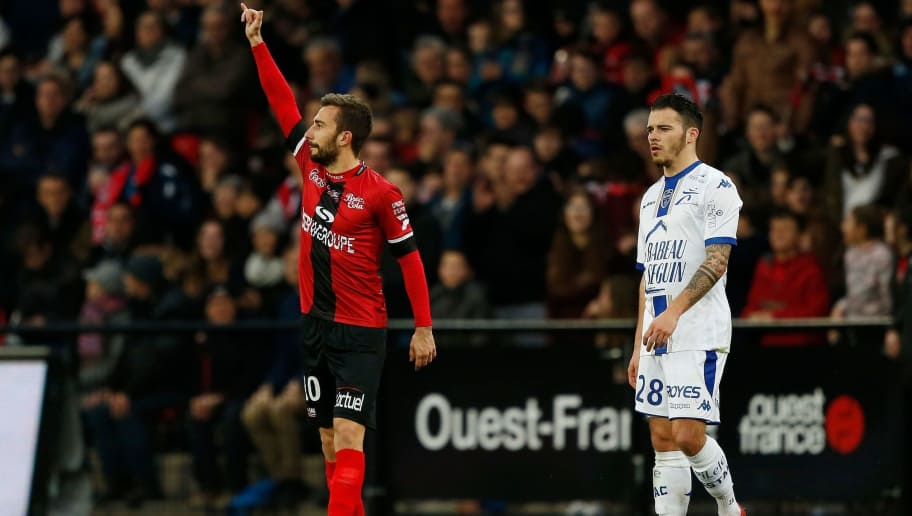 Guingamp's French midfielder Nicolas Benezet (L) celebrates after scoring a goal during the French L1 football match between Guingamp (EAG) and Troyes (ESTAC) on April 7, 2018 at the Roudourou Stadium in Guingamp, northwestern France. / AFP PHOTO / CHARLY TRIBALLEAU        (Photo credit should read CHARLY TRIBALLEAU/AFP/Getty Images)