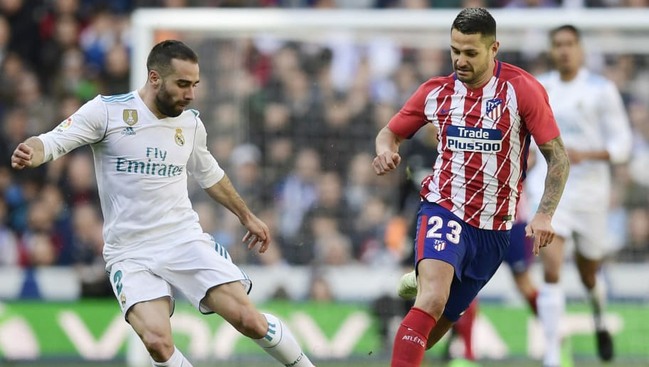 Real Madrid's Spanish defender Dani Carvajal (L) vies with Atletico Madrid's Spanish forward Vitolo during the Spanish league football match between Real Madrid CF and Club Atletico de Madrid at the Santiago Bernabeu stadium in Madrid on April 8, 2018. / AFP PHOTO / JAVIER SORIANO        (Photo credit should read JAVIER SORIANO/AFP/Getty Images)