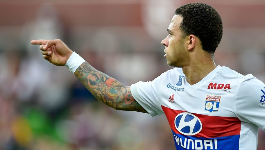Lyon's Dutch forward Memphis Depay celebrates after scoring a goal during the French L1 football match between Metz (FCM) and Lyon (OL) on April 8, 2018 at Saint Symphorien stadium in Longeville-Les-Metz, eastern France.  / AFP PHOTO / JEAN-CHRISTOPHE VERHAEGEN        (Photo credit should read JEAN-CHRISTOPHE VERHAEGEN/AFP/Getty Images)