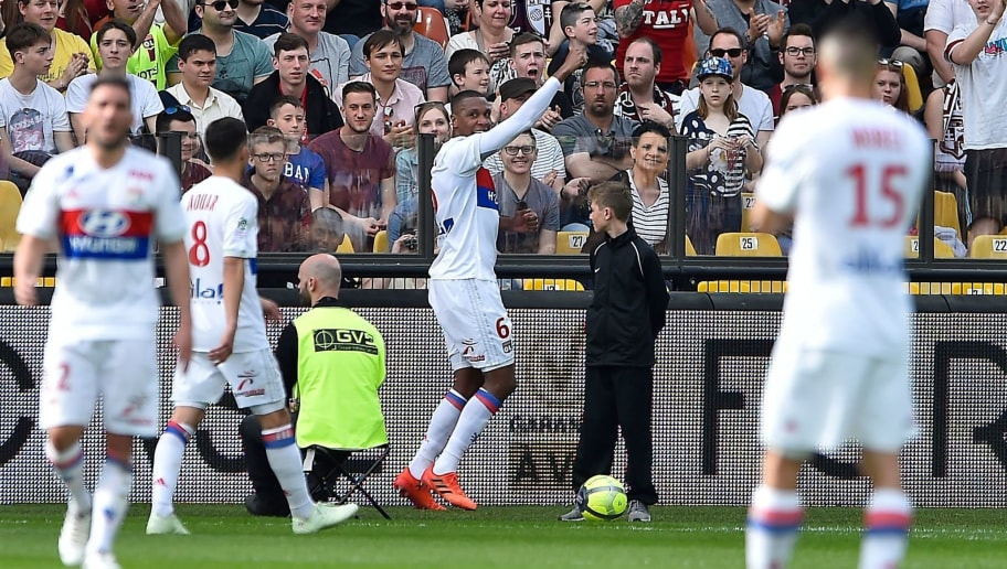 Lyon's Brazilian defender Marcelo (C) celebrates after scoring a goal during the French L1 football match between Metz (FCM) and Lyon (OL) on April 8, 2018 at Saint Symphorien stadium in Longeville-Les-Metz, eastern France.  / AFP PHOTO / JEAN-CHRISTOPHE VERHAEGEN        (Photo credit should read JEAN-CHRISTOPHE VERHAEGEN/AFP/Getty Images)