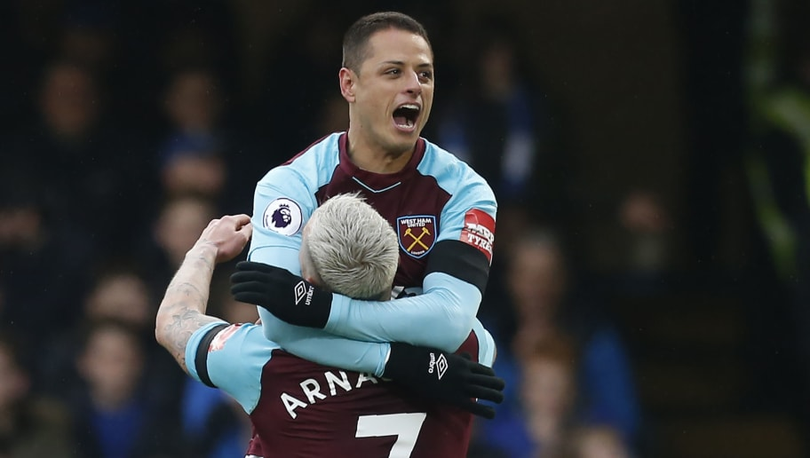 West Ham United's Mexican striker Javier Hernandez (R) celebrates with West Ham United's Austrian midfielder Marko Arnautovic after scoring their first goal during the English Premier League football match between Chelsea and West Ham United at Stamford Bridge in London on April 8, 2018. / AFP PHOTO / Ian KINGTON / RESTRICTED TO EDITORIAL USE. No use with unauthorized audio, video, data, fixture lists, club/league logos or 'live' services. Online in-match use limited to 75 images, no video emulation. No use in betting, games or single club/league/player publications.  /         (Photo credit should read IAN KINGTON/AFP/Getty Images)
