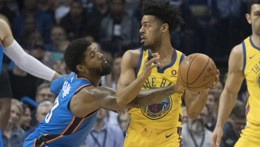 OKLAHOMA CITY, OK - APRIL 3: Paul George #13 of the Oklahoma City Thunder steals the ball from Quinn Cook #4 of the Golden State Warriors during the first half of a NBA  game at the Chesapeake Energy Arena on April 3, 2018 in Oklahoma City, Oklahoma. NOTE TO USER: User expressly acknowledges and agrees that, by downloading and or using this photograph, User is consenting to the terms and conditions of the Getty Images License Agreement. (Photo by J Pat Carter/Getty Images)