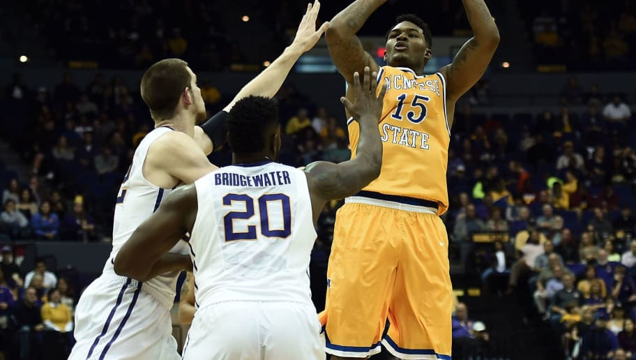 BATON ROUGE, LA - NOVEMBER 13:  Craig McFerrin #15 of the McNeese State Cowboys shoots over Darcy Malone #22 and Brian Bridgewater #20 of the LSU Tigers during the second half of a game at the Pete Maravich Assembly Center on November 13, 2015 in Baton Rouge, Louisiana.  (Photo by Stacy Revere/Getty Images)