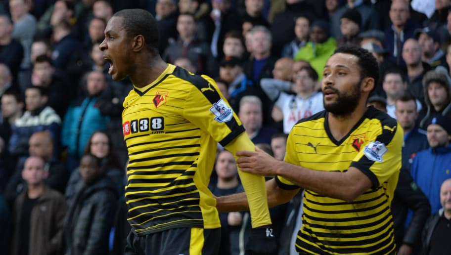 Watford's Nigerian striker Odion Ighalo (L) celebrates with Watford's Scottish midfielder Ikechi Anya (R) after scoring their first goal during the English Premier League football match between Watford and Tottenham Hotspur at Vicarage Road Stadium in Watford, north of London on December 28, 2015. AFP PHOTO / OLLY GREENWOOD  RESTRICTED TO EDITORIAL USE. NO USE WITH UNAUTHORIZED AUDIO, VIDEO, DATA, FIXTURE LISTS, CLUB/LEAGUE LOGOS OR 'LIVE' SERVICES. ONLINE IN-MATCH USE LIMITED TO 75 IMAGES, NO VIDEO EMULATION. NO USE IN BETTING, GAMES OR SINGLE CLUB/LEAGUE/PLAYER PUBLICATIONS. / AFP / OLLY GREENWOOD        (Photo credit should read OLLY GREENWOOD/AFP/Getty Images)