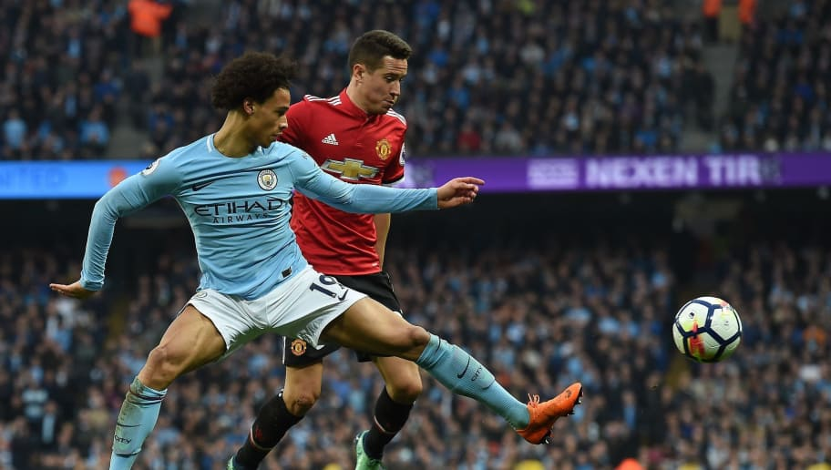 Manchester City's German midfielder Leroy Sane (L) vies with Manchester United's Spanish midfielder Ander Herrera during the English Premier League football match between Manchester City and Manchester United at the Etihad Stadium in Manchester, north west England, on April 7, 2018. / AFP PHOTO / PAUL ELLIS / RESTRICTED TO EDITORIAL USE. No use with unauthorized audio, video, data, fixture lists, club/league logos or 'live' services. Online in-match use limited to 75 images, no video emulation. No use in betting, games or single club/league/player publications.  /         (Photo credit should read PAUL ELLIS/AFP/Getty Images)