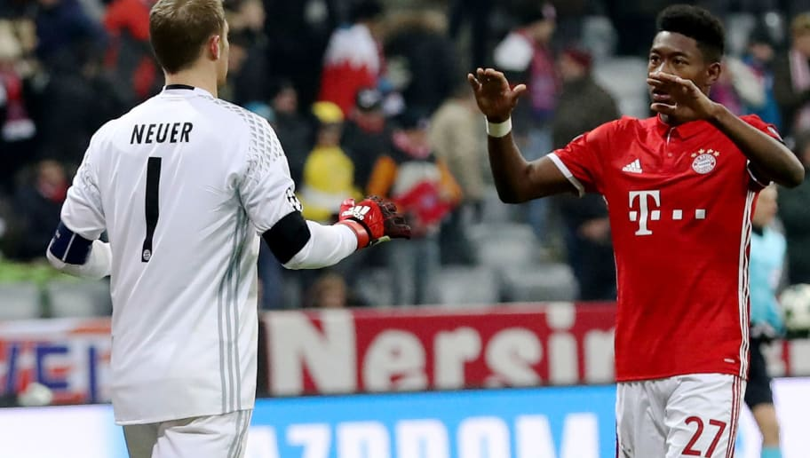 MUNICH, GERMANY - DECEMBER 06: Manuel Neuer (L), goalkeeper of Bayern celebrate with team mate David Alaba after the UEFA Champions League match between FC Bayern Muenchen and Club Atletico de Madrid at Allianz Arena on December 6, 2016 in Munich, Bavaria, Germany.  (Photo by Maja Hitij/Bongarts/Getty Images)