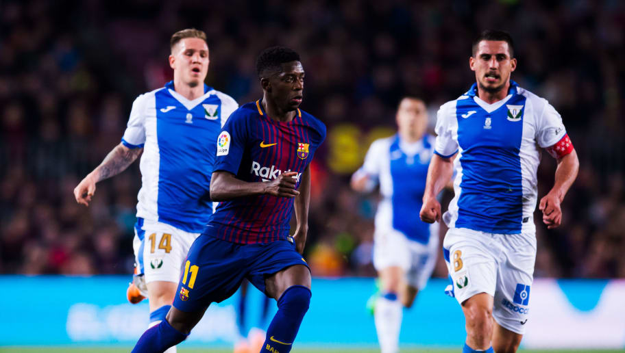 BARCELONA, SPAIN - APRIL 07: Ousmane Dembele of FC Barcelona runs with the ball during the La Liga match between Barcelona and Leganes at Camp Nou on April 7, 2018 in Barcelona, Spain. (Photo by Alex Caparros/Getty Images)