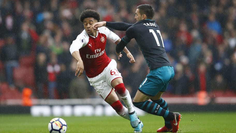 LONDON, ENGLAND - APRIL 08:  Reiss Nelson of Arsenal and Dusan Tadic of Southampton battle for possession during the Premier League match between Arsenal and Southampton at Emirates Stadium on April 8, 2018 in London, England.  (Photo by Julian Finney/Getty Images)