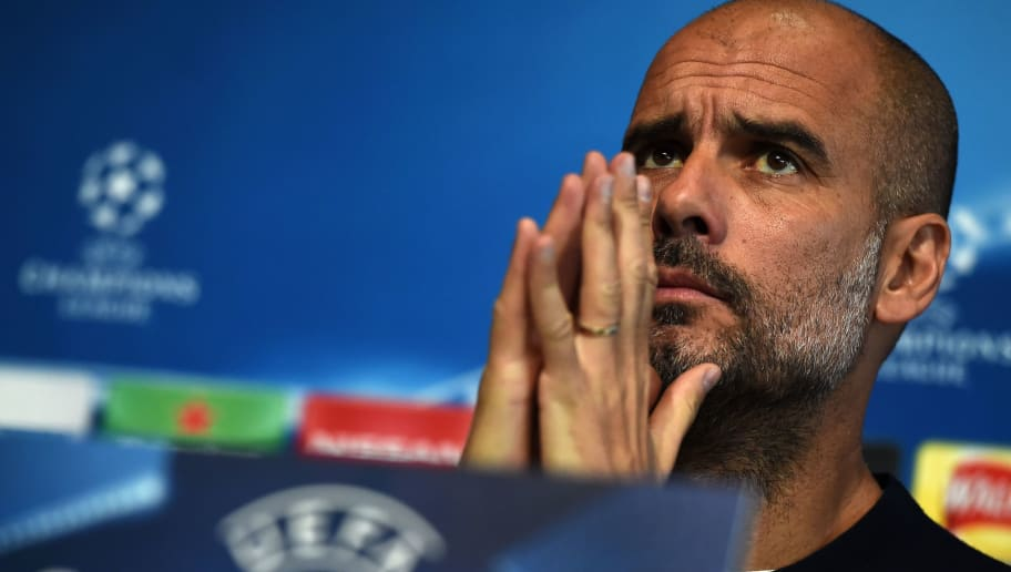 Manchester City's Spanish manager Pep Guardiola attends a press conference prior to the UEFA Champions League second leg quarter-final football match between Manchester City and Liverpool, at City Football Academy in Manchester, north west England on April 9, 2018. / AFP PHOTO / PAUL ELLIS        (Photo credit should read PAUL ELLIS/AFP/Getty Images)