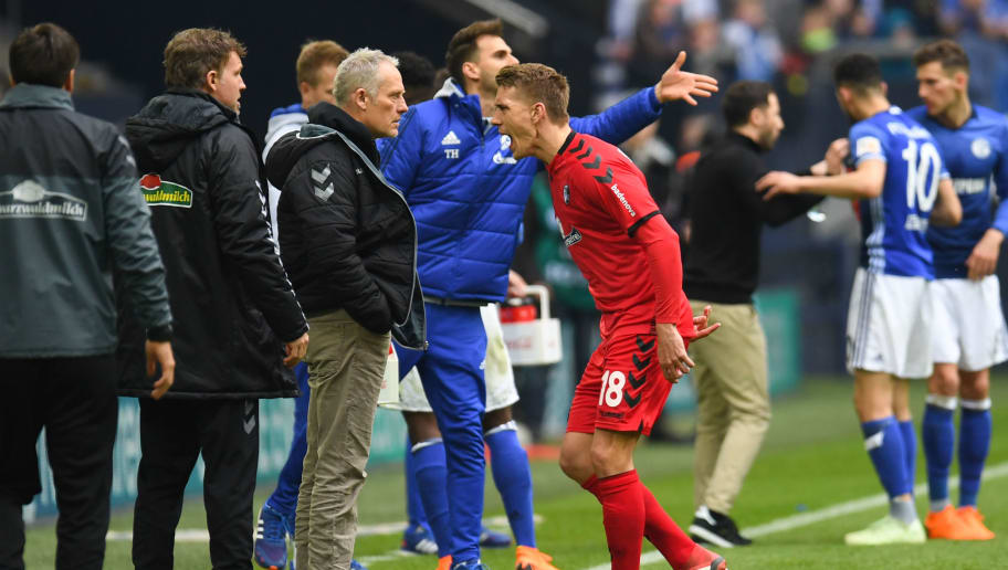 Freiburg's German forward Nils Petersen reacts as he leaves the pitch after receiving the red card during the German first division Bundesliga football match FC Schalke 04 vs SC Freiburg, in Gelsenkirchen, western Germany, on March 31, 2018. / AFP PHOTO / Patrik STOLLARZ / RESTRICTIONS: DURING MATCH TIME: DFL RULES TO LIMIT THE ONLINE USAGE TO 15 PICTURES PER MATCH AND FORBID IMAGE SEQUENCES TO SIMULATE VIDEO. == RESTRICTED TO EDITORIAL USE == FOR FURTHER QUERIES PLEASE CONTACT DFL DIRECTLY AT + 49 69 650050         (Photo credit should read PATRIK STOLLARZ/AFP/Getty Images)