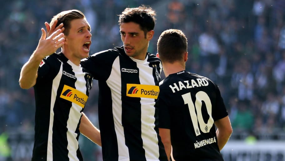 MOENCHENGLADBACH, GERMANY - APRIL 07: Patrick Herrmann of Moenchengladbach (L) celebrates his first goal with Lars Stindl of Moenchengladbach (C) but the goal is rejected during the Bundesliga match between Borussia Moenchengladbach and Hertha BSC at Borussia-Park on April 7, 2018 in Moenchengladbach, Germany. (Photo by Christof Koepsel/Bongarts/Getty Images)