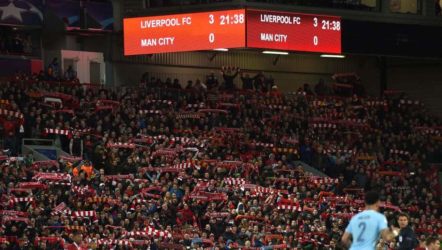 Supporters cheer during the UEFA Champions League first leg quarter-final football match between Liverpool and Manchester City, at Anfield stadium in Liverpool, north west England on April 4, 2018. / AFP PHOTO / PAUL ELLIS        (Photo credit should read PAUL ELLIS/AFP/Getty Images)