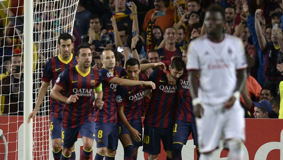 Barcelona's players celebrate after scoring a goal during the UEFA Champions league football match FC Barcelona vs AC Milan at the Camp Nou stadium in Barcelona on November 6,  vies with 2013. AFP PHOTO/ LLUIS GENE        (Photo credit should read LLUIS GENE/AFP/Getty Images)