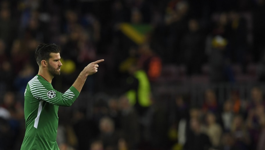 Roma's Brazilian goalkeeper Alisson Becker gestures at the end of the UEFA Champions League quarter-final first leg football match between FC Barcelona and AS Roma at the Camp Nou Stadium in Barcelona on April 4, 2018. / AFP PHOTO / LLUIS GENE        (Photo credit should read LLUIS GENE/AFP/Getty Images)