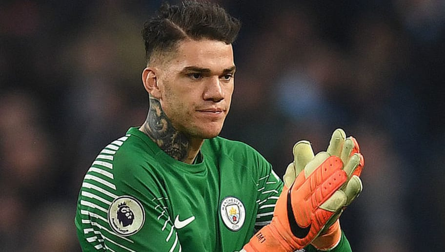 Manchester City's Brazilian goalkeeper Ederson applauds the fans following the English Premier League football match between Manchester City and Manchester United at the Etihad Stadium in Manchester, north west England, on April 7, 2018. Manchester United won the match 3-2. / AFP PHOTO / Paul ELLIS / RESTRICTED TO EDITORIAL USE. No use with unauthorized audio, video, data, fixture lists, club/league logos or 'live' services. Online in-match use limited to 75 images, no video emulation. No use in betting, games or single club/league/player publications.  /         (Photo credit should read PAUL ELLIS/AFP/Getty Images)
