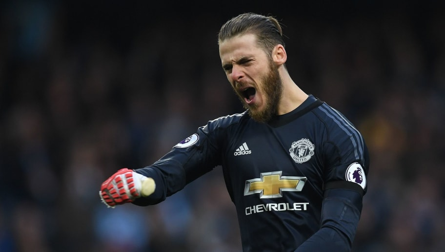 Manchester United's Spanish goalkeeper David de Gea reacts after Manchester United's English defender Chris Smalling (unseen) scored his team's third goal during the English Premier League football match between Manchester City and Manchester United at the Etihad Stadium in Manchester, north west England, on April 7, 2018. / AFP PHOTO / Paul ELLIS / RESTRICTED TO EDITORIAL USE. No use with unauthorized audio, video, data, fixture lists, club/league logos or 'live' services. Online in-match use limited to 75 images, no video emulation. No use in betting, games or single club/league/player publications.  /         (Photo credit should read PAUL ELLIS/AFP/Getty Images)
