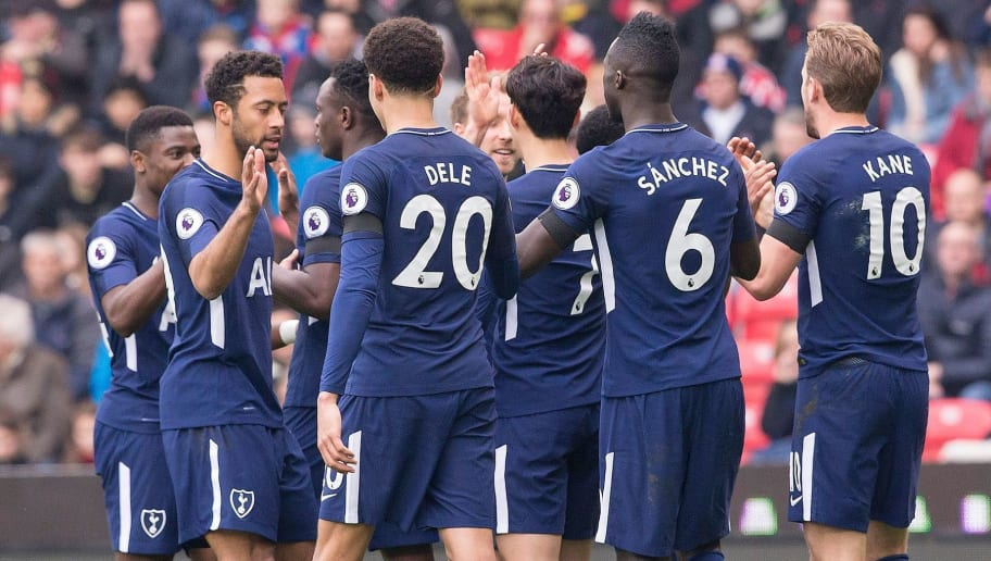 Tottenham Hotspur's English striker Harry Kane (R) celebrates with teammates after Tottenham Hotspur's Danish midfielder Christian Eriksen crossed the ball to him to score his team's second goal during the English Premier League football match between Stoke City and Tottenham Hotspur at the Bet365 Stadium in Stoke-on-Trent, central England on April 7, 2018. / AFP PHOTO / Roland Harrison / RESTRICTED TO EDITORIAL USE. No use with unauthorized audio, video, data, fixture lists, club/league logos or 'live' services. Online in-match use limited to 75 images, no video emulation. No use in betting, games or single club/league/player publications.  /         (Photo credit should read ROLAND HARRISON/AFP/Getty Images)