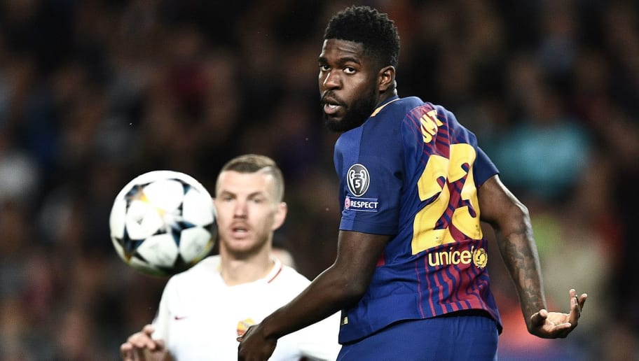 Barcelona's French defender Samuel Umtiti heads the ball past Roma's Bosnian striker Edin Dzeko (back) during the UEFA Champions League quarter-final first leg football match between Barcelona and AS Roma at the Camp Nou Stadium in Barcelona on April 4, 2018. / AFP PHOTO / Filippo MONTEFORTE        (Photo credit should read FILIPPO MONTEFORTE/AFP/Getty Images)