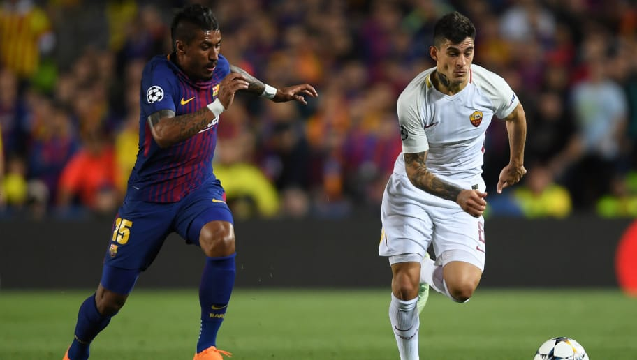 BARCELONA, SPAIN - APRIL 04:  Paulinho of Barcelona challenges Diego Perotti of Roma during the UEFA Champions League Quarter Final Leg One between FC Barcelona and AS Roma at Camp Nou on April 4, 2018 in Barcelona, Spain.  (Photo by Mike Hewitt/Getty Images)