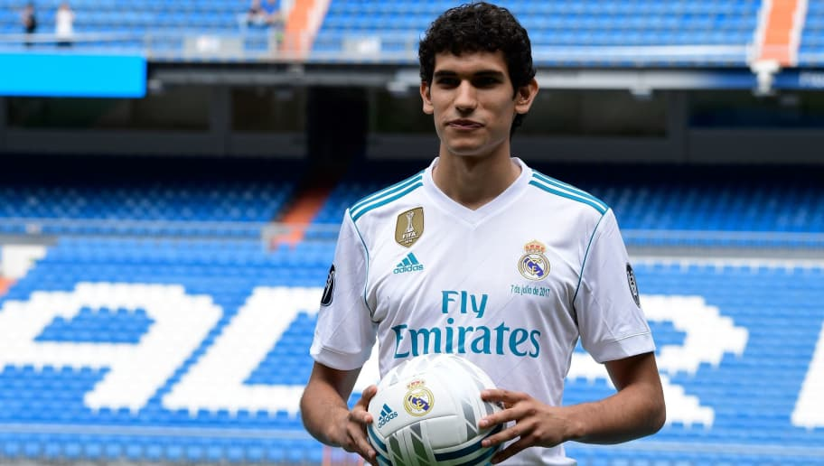 Real Madrid's new player Jesus Vallejo poses with the ball after his official presentation at the Santiago Bernabeu stadium in Madrid, on July 7, 2017. / AFP PHOTO / JAVIER SORIANO        (Photo credit should read JAVIER SORIANO/AFP/Getty Images)