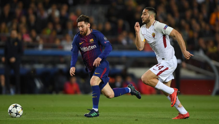 BARCELONA, SPAIN - APRIL 04:  Lionel Messi of Barcelona gets away from Konstantinos Manolas of Roma during the UEFA Champions League Quarter Final Leg One between FC Barcelona and AS Roma at Camp Nou on April 4, 2018 in Barcelona, Spain.  (Photo by Mike Hewitt/Getty Images)