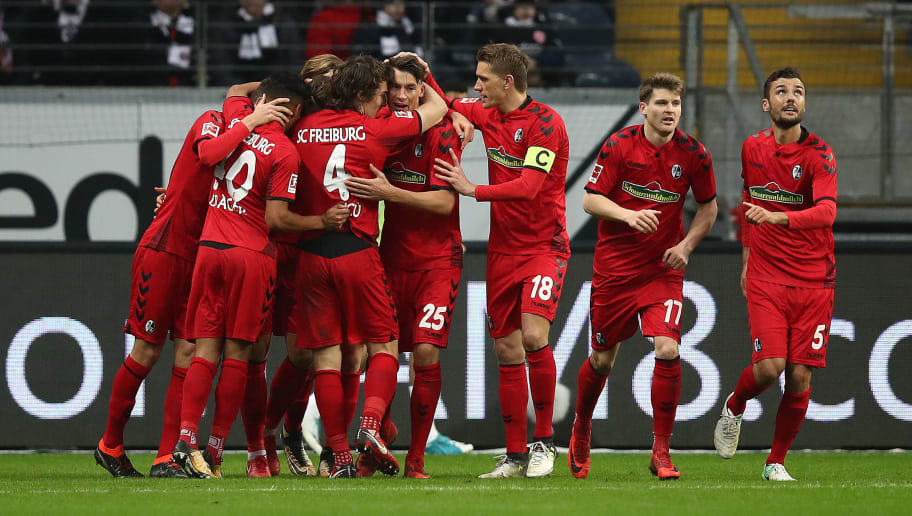 FRANKFURT AM MAIN, GERMANY - JANUARY 13: Robin Koch of Freiburg (25) is celebrated by his team after he scored a goal to make it 1:1 during the Bundesliga match between Eintracht Frankfurt and Sport-Club Freiburg at Commerzbank-Arena on January 13, 2018 in Frankfurt am Main, Germany. (Photo by Maja Hitij/Bongarts/Getty Images)