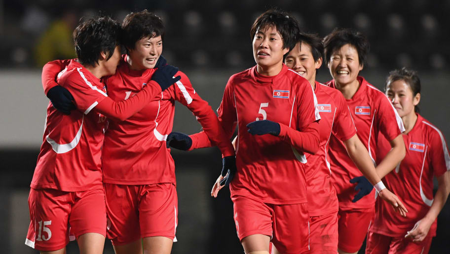 CHIBA, JAPAN - DECEMBER 15:  North Korean players celebrate the East Asian Champions following their 2-0 victory in the EAFF E-1 Women's Football Championship between Japan and North Korea at Fukuda Denshi Arena on December 15, 2017 in Chiba, Japan.  (Photo by Masashi Hara/Getty Images)