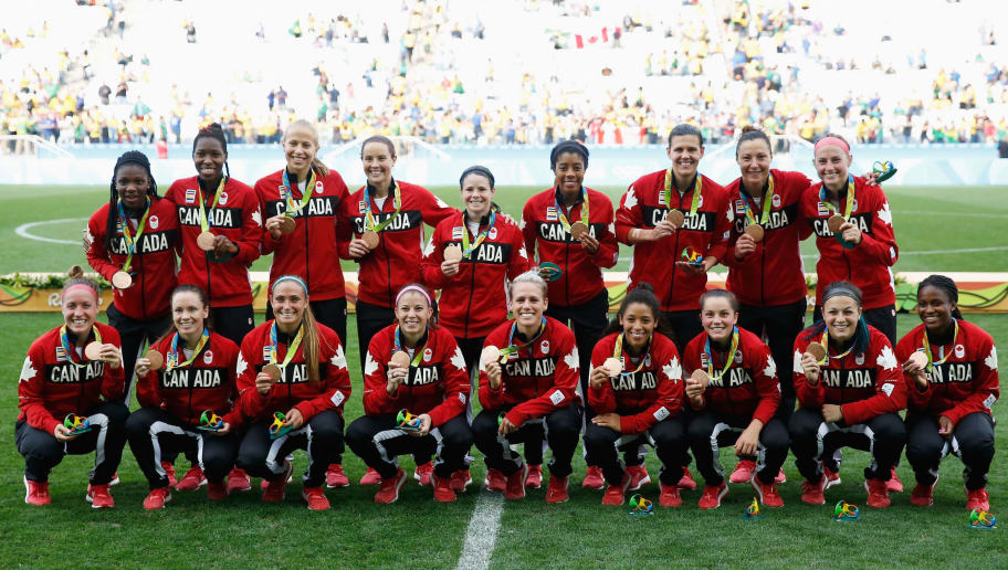 SAO PAULO, BRAZIL - AUGUST 19:  Canadian team celebrates with their medals following victory during the Women's Olympic Football Bronze Medal match between Brazil and Canada at Arena Corinthians on August 19, 2016 in Sao Paulo, Brazil.  (Photo by Alexandre Schneider/Getty Images)