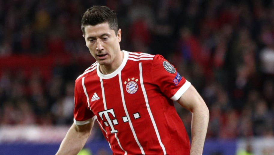 SEVILLE, SPAIN - APRIL 03: Robert Lewandowski of Bayern Muenchen passes the ball during the UEFA Champions League Quarter Final Leg One match between Sevilla FC and Bayern Muenchen at Estadio Ramon Sanchez Pizjuan on April 3, 2018 in Seville, Spain.  (Photo by Adam Pretty/Getty Images)