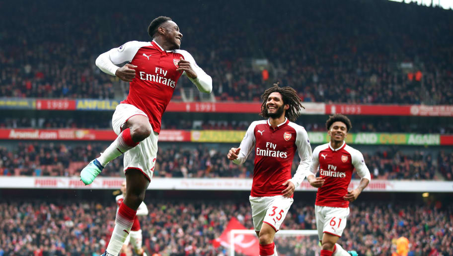 LONDON, ENGLAND - APRIL 08:  Danny Welbeck of Arsenal celebrates with team mate Mohamed Elneny and Reiss Nelson after scoring his sides second goal during the Premier League match between Arsenal and Southampton at Emirates Stadium on April 8, 2018 in London, England.  (Photo by Julian Finney/Getty Images)