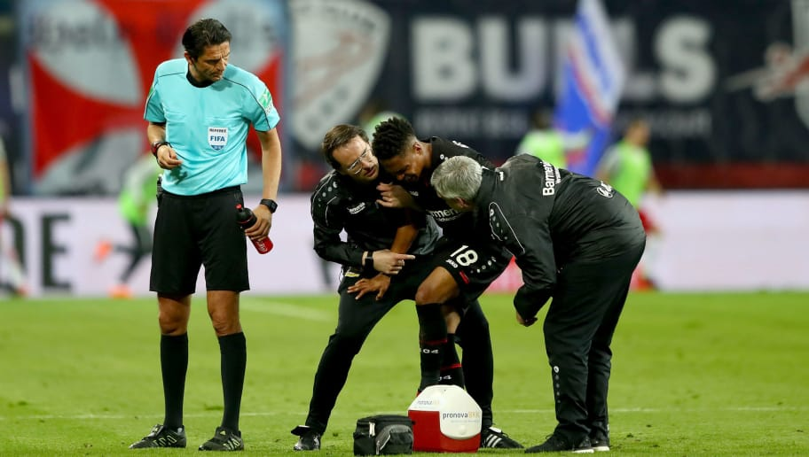 LEIPZIG, GERMANY - APRIL 09:  Wendell of Leverkusen gets medical treatment during the Bundesliga match between RB Leipzig and Bayer 04 Leverkusen at Red Bull Arena on April 9, 2018 in Leipzig, Germany.  (Photo by Martin Rose/Bongarts/Getty Images)