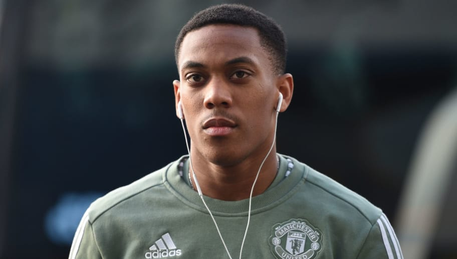 Manchester United's French striker Anthony Martial arrives ahead of the English FA Cup fifth round football match between Huddersfield Town and Manchester United at the John Smith's stadium in Huddersfield, northern England on February 17, 2018. / AFP PHOTO / Oli SCARFF / RESTRICTED TO EDITORIAL USE. No use with unauthorized audio, video, data, fixture lists, club/league logos or 'live' services. Online in-match use limited to 75 images, no video emulation. No use in betting, games or single club/league/player publications.  /         (Photo credit should read OLI SCARFF/AFP/Getty Images)