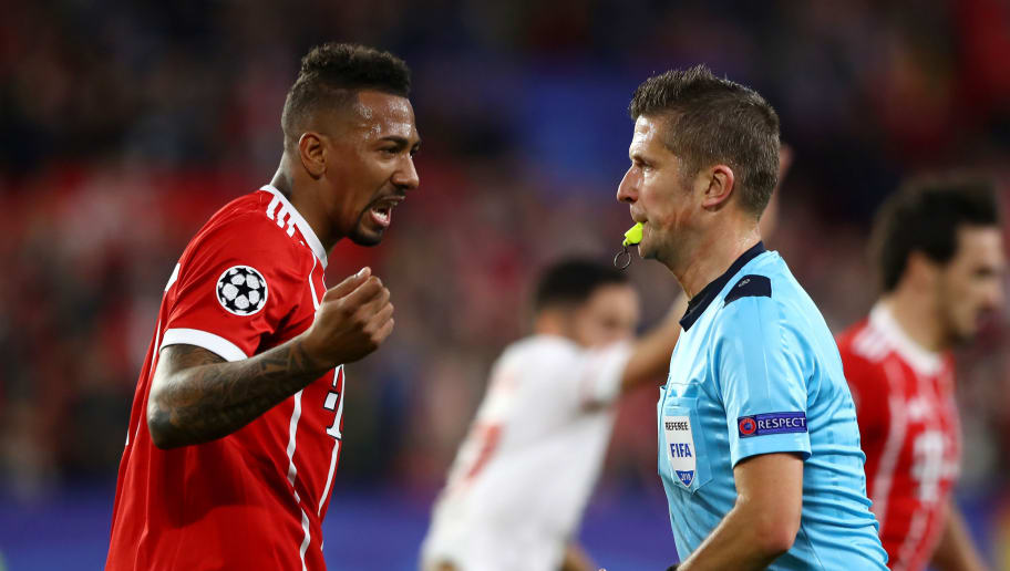 SEVILLE, SPAIN - APRIL 03: Jerome Boateng of Bayern Muenchen argues with referee Daniele Orsato during the UEFA Champions League Quarter Final Leg One match between Sevilla FC and Bayern Muenchen at Estadio Ramon Sanchez Pizjuan on April 3, 2018 in Seville, Spain.  (Photo by Martin Rose/Bongarts/Getty Images)