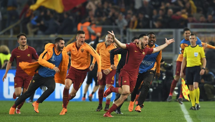 AS Roma's Greek defender Kostas Manolas (R) celebrates after scoring a goal during the UEFA Champions League quarter-final second leg football match between AS Roma and FC Barcelona at the Olympic Stadium in Rome on April 10, 2018. / AFP PHOTO / LLUIS GENE        (Photo credit should read LLUIS GENE/AFP/Getty Images)