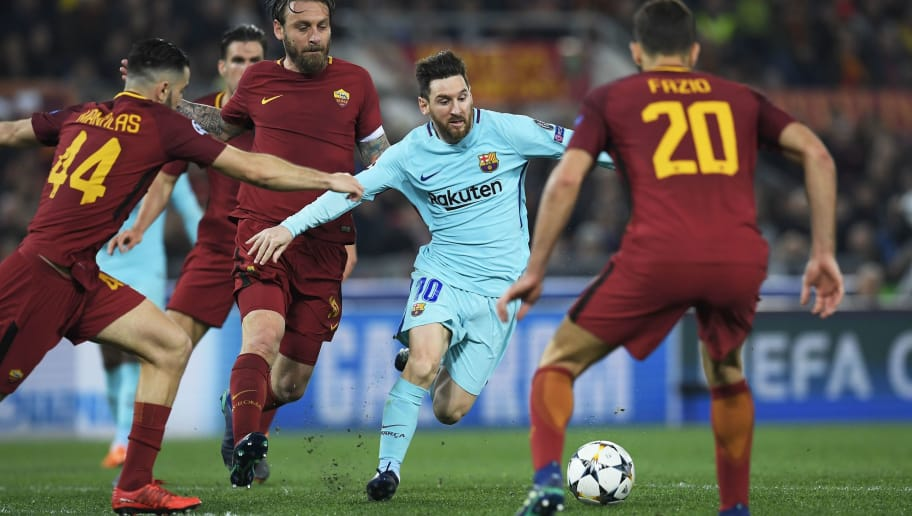 FC Barcelona's Argentinian forward Lionel Messi (C) vies for the ball with AS Roma's Italian midfielder Daniele De Rossi (2L) during the UEFA Champions League quarter-final second leg football match between AS Roma and FC Barcelona at the Olympic Stadium in Rome on April 10, 2018. / AFP PHOTO / LLUIS GENE        (Photo credit should read LLUIS GENE/AFP/Getty Images)