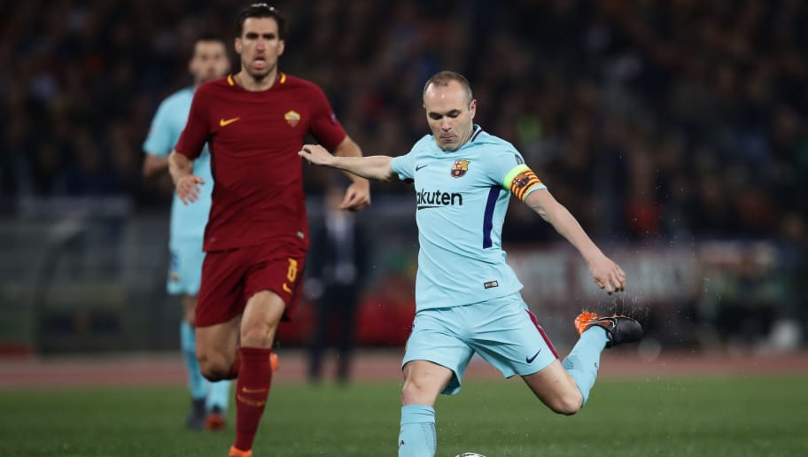 FC Barcelona's Spanish midfielder Andres Iniesta (R) kicks the ball during the UEFA Champions League quarter-final second leg football match between AS Roma and FC Barcelona at the Olympic Stadium in Rome on April 10, 2018. / AFP PHOTO / Isabella BONOTTO        (Photo credit should read ISABELLA BONOTTO/AFP/Getty Images)