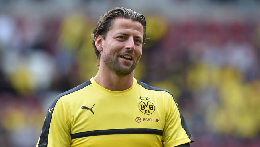 Dortmund's goalkeeper Roman Weidenfeller is pictured prior to the German first division Bundesliga football match between FC Augsburg and Borussia Dortmund on May 13, 2017 in Augsburg, southern Germany.  / AFP PHOTO / Christof STACHE / RESTRICTIONS: DURING MATCH TIME: DFL RULES TO LIMIT THE ONLINE USAGE TO 15 PICTURES PER MATCH AND FORBID IMAGE SEQUENCES TO SIMULATE VIDEO. == RESTRICTED TO EDITORIAL USE == FOR FURTHER QUERIES PLEASE CONTACT DFL DIRECTLY AT + 49 69 650050         (Photo credit should read CHRISTOF STACHE/AFP/Getty Images)