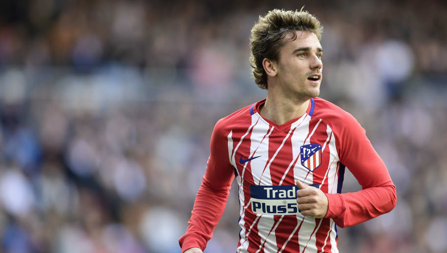 Atletico Madrid's French forward Antoine Griezmann celebrates a goal during the Spanish league football match between Real Madrid CF and Club Atletico de Madrid at the Santiago Bernabeu stadium in Madrid on April 8, 2018. / AFP PHOTO / JAVIER SORIANO        (Photo credit should read JAVIER SORIANO/AFP/Getty Images)