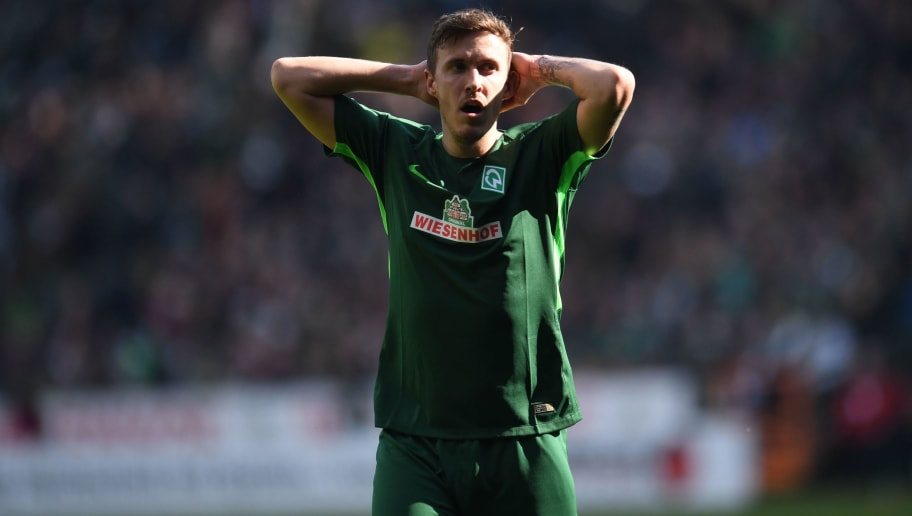 Bremen's German forward Max Kruse reacts during the German first division Bundesliga football match Werder Bremen vs Eintracht Frankfurt, in Bremen, northern Germany, on April 1, 2018. / AFP PHOTO / Patrik STOLLARZ / RESTRICTIONS: DURING MATCH TIME: DFL RULES TO LIMIT THE ONLINE USAGE TO 15 PICTURES PER MATCH AND FORBID IMAGE SEQUENCES TO SIMULATE VIDEO. == RESTRICTED TO EDITORIAL USE == FOR FURTHER QUERIES PLEASE CONTACT DFL DIRECTLY AT + 49 69 650050         (Photo credit should read PATRIK STOLLARZ/AFP/Getty Images)