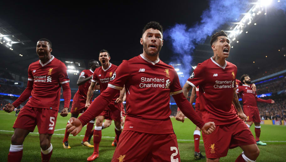 MANCHESTER, ENGLAND - APRIL 10:  Alex Oxlade-Chamberlain and Roberto Firmino of Liverpool celebrate their sides first goal scored by Mohamed Salah during the Quarter Final Second Leg match between Manchester City and Liverpool at Etihad Stadium on April 10, 2018 in Manchester, England.  (Photo by Laurence Griffiths/Getty Images,)